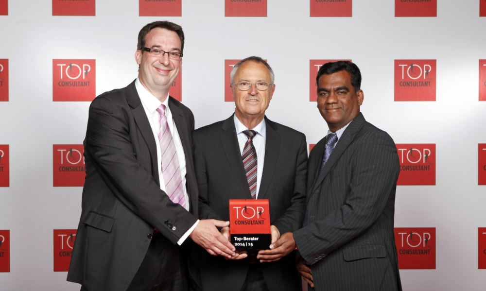 RheinBrücke IT Consulting management receiving the 'Top Consultant' for the year 2014- 2015 recognition in Germany